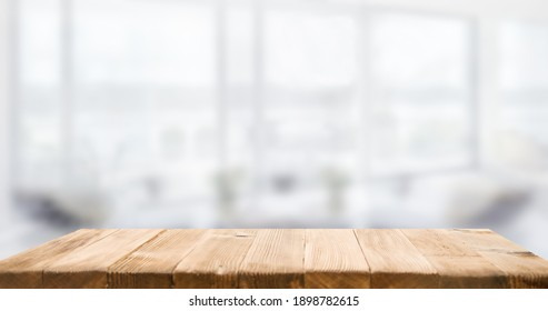 empty wooden table on background of abstract blur white interior, montage, product display, inside and window.