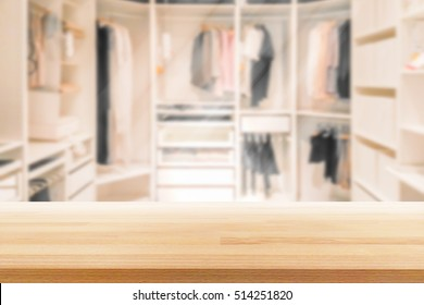 Empty wooden table on a background blur closet in the room  for display or montage your products