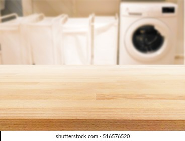 Empty wooden table on a background blur Laundry room  for display or montage your products