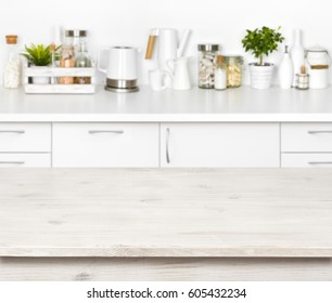 Empty wooden table on blurred background of various kitchen objects