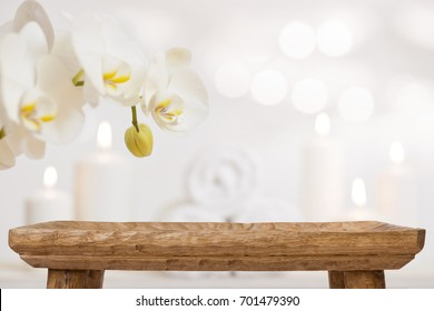 Empty wooden table on blurred abstract background of spa products