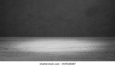 Empty wooden table on on dark loft wall background, using for studio background and product display concept