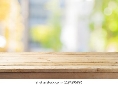Empty wooden table  over abstract bokeh background