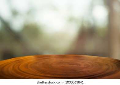 empty wooden table over blur montage abstract background