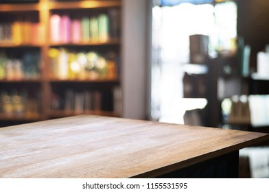empty wooden table over blurred restaurant background