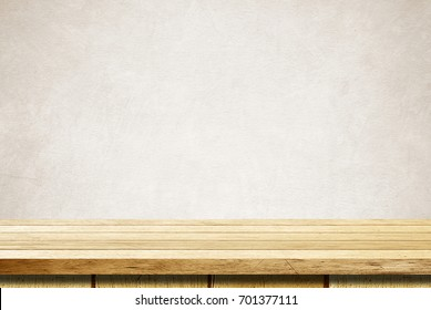 Empty wooden table over brown grunge cement wall, vintage, background, template, product display montage