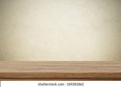 Empty wooden table over cement wall background, product display montage