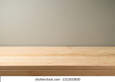 Empty wooden table over grey wall background. Can be used for food stand. key visual layout  or new product advertising display