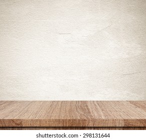 Empty wooden table over grunge cement wall, vintage, background, template, display