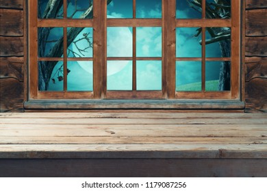 Empty wooden table over wooden window background. Halloween night concept