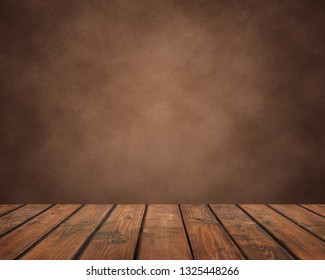 empty wooden table of planks on a brown grunge background.  countertop, work surface on the back of the wall. Empty space for Your subject.