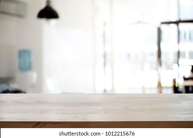 Empty wooden table platform blur office background for presentation product.