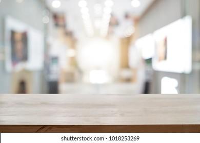 Empty wooden table platform blur smart phone shop background