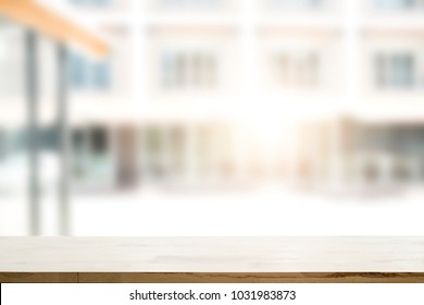 Empty wooden table platform blur background for presentation product.