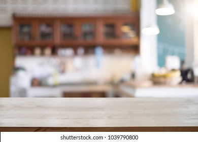 Empty wooden table platform blur of kitchen background for presentation product.