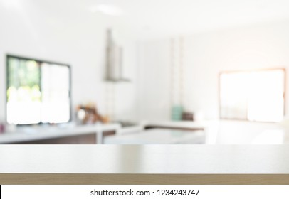 Empty wooden table platform blur kitchen background for presentation product.