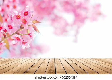 Empty wooden table platform with Cherry blossom background. For product display