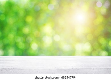 Empty wooden table platform over Nature bokeh garden background for presentation product