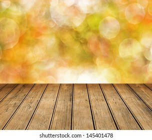 Empty wooden table for product display montages - autumn theme