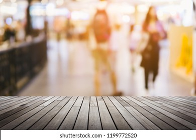 Empty wooden table space platform and blurred shopping mall or shopping center background for product.