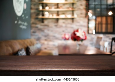Empty wooden table space platform and blurred resturant or coffee shop background for product display montage.