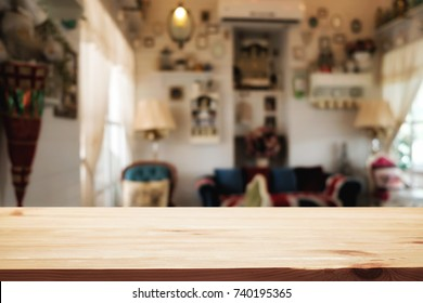 Empty wooden table space platform and blurred resturant or coffee shop background for product display montage