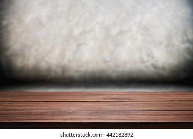 Empty wooden table space polished concrete surface background. For product display presentation.