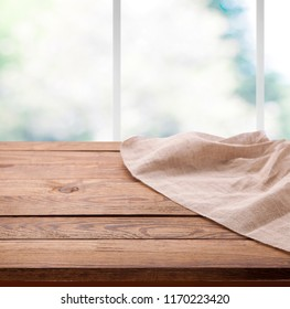 Empty wooden table with tablecloth. Napkin closeup top view mock up. Kitchen rustic background.