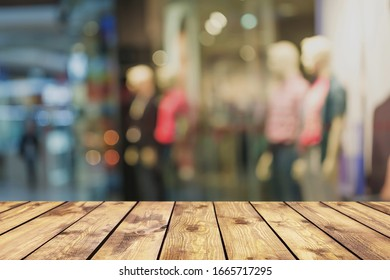 Empty wooden table top in front of abstract blurred bokeh background