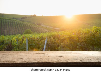 empty wooden table and Tuscan landscape at sunrise
