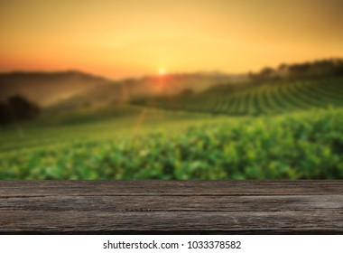 Empty wooden table with view of mountain or wooden desk with tea plantation nature with bokeh background, copy space for your text