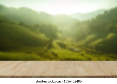 Empty wooden table with view of mountain or wooden desk with plantation nature with bokeh background, copy space for your text