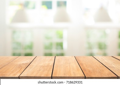 Empty wooden table and white modern kitchen cafe background,resturant. Ready for product montage