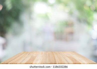 Empty wooden table and window room interior decoration background, product montage display,can be used for display or montage your products.Mock up for display of product.