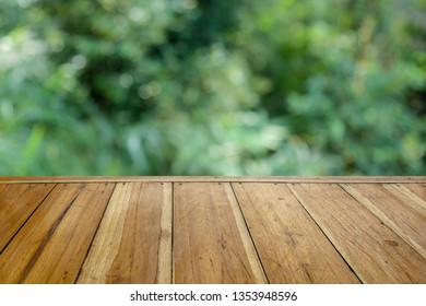Empty Wooden table for your product and blur natural background, Wood table background nature montage