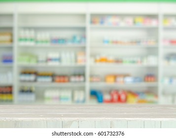 Empty wooden tabletop with blurred of medicine or cosmetic background