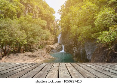 Empty wooden terrace with Stream in forest, Nature rill flow on background
