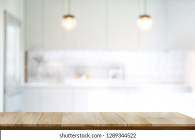 Empty wooden top table or cutting counter table in modern kitchen room background. For product or food montage