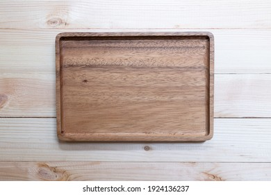 Empty wooden tray, Cutting board. Table background. Top view