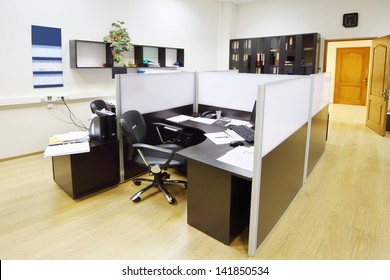 Empty working area with armchair and table in modern office.