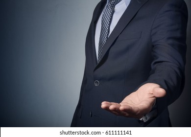 An empty workpiece. Gesture of alms begging. Businessman stretches out his hand.