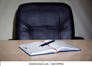 Empty workplace in office on gray background