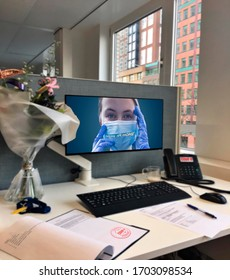 """Empty workplace in the office and Text """" Stay at HOME"""" inscription on the monitor.Work from home. Remote work  due to the coronavirus pandemic"""