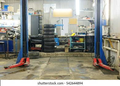 Empty workshop with a lift in a car repair station