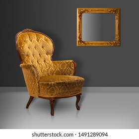 Empty worn vintage upholstered armchair in sparse environment with golden picture frame on wall