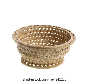 empty woven straw basket isolated on white background
