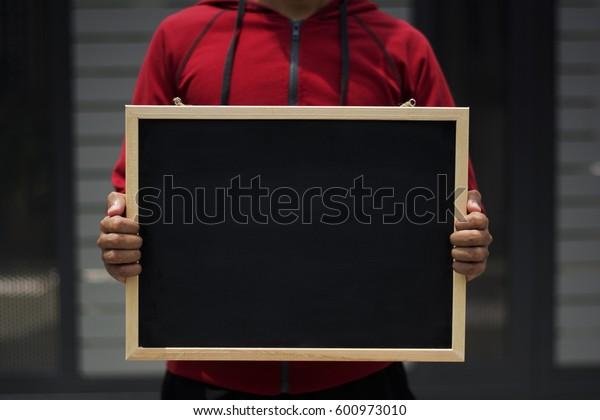 empty written on blackboard with someone is holding it