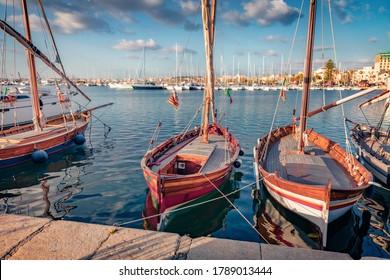 Empty yacht on Alghero port, Province of Sassari, Italy, Europe. Splendid summer view of Sardinia island, Mediterranean seascape. Traveling concept background.