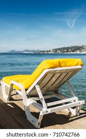 Empty yellow beach lounge overlooking the Mediterranean Sea in Juan les Pins, France