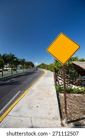 Empty yellow road sign. Tropical street